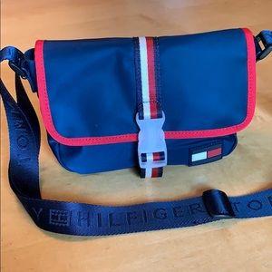 A blue Tommy Hilfiger crossbody bag